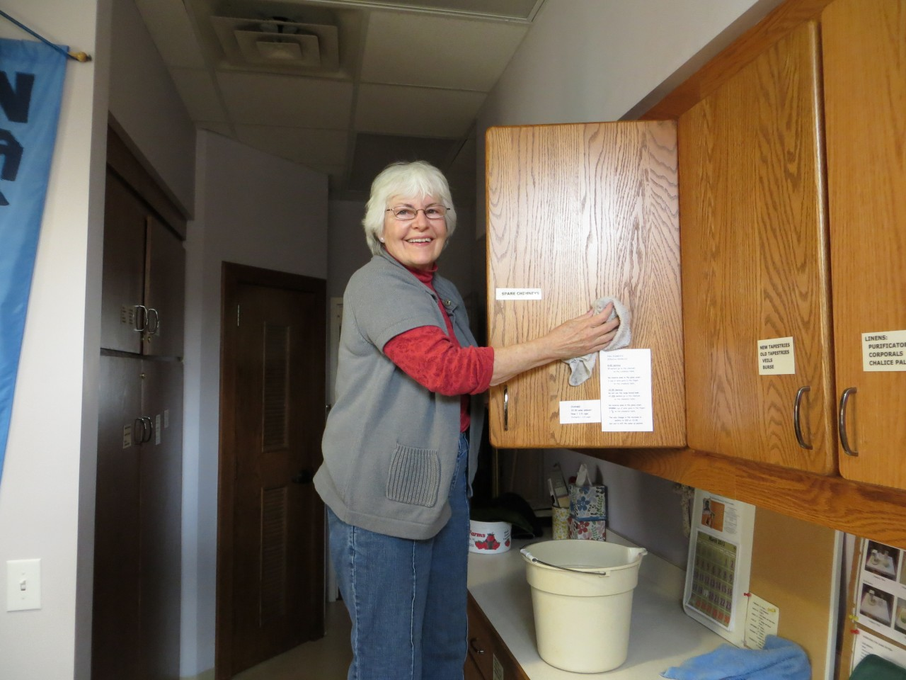Altar Guild member Pat cleaning the cupboards