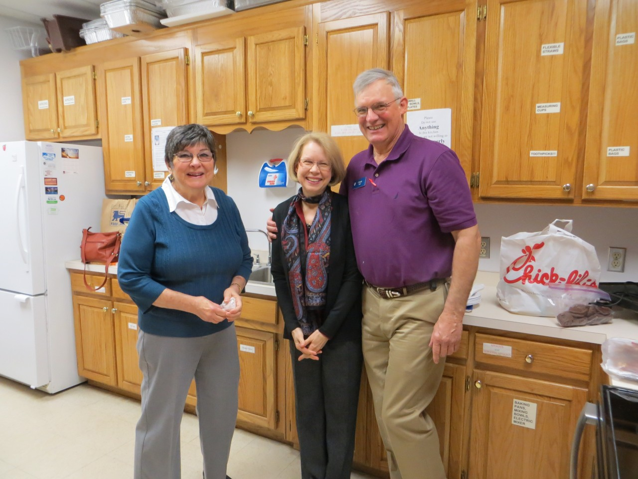 Sandy, Carolyn, and Charly are in the kitchen preparing food for Fellowship.