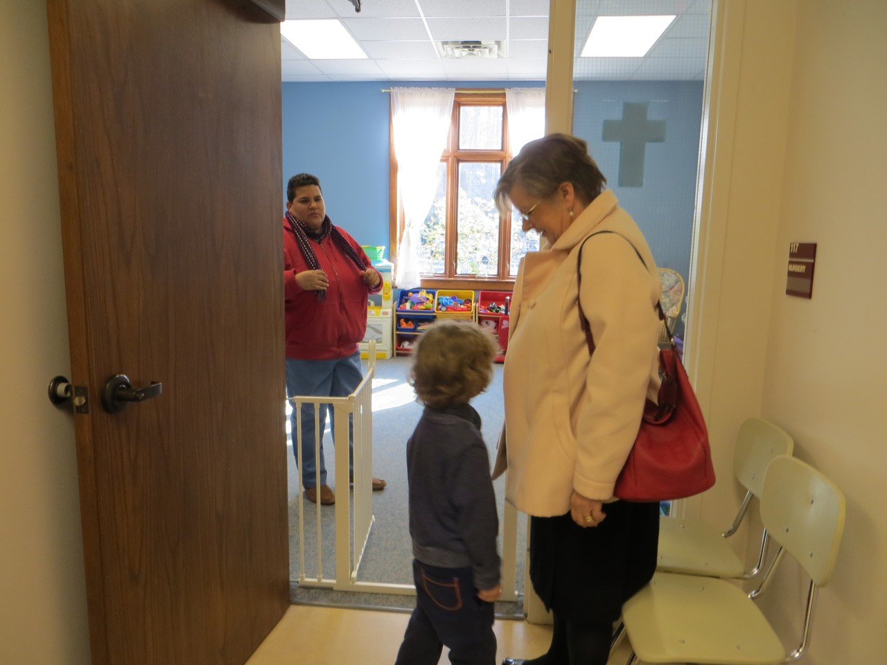 Nanny Nina greets our youngest parishioners at the door to the nursery.
