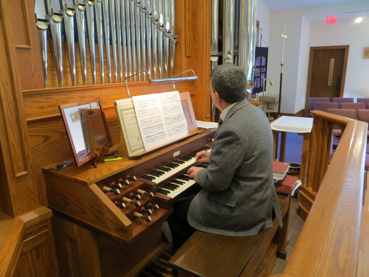 Organist Jason practices between services.