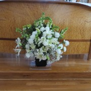 flowers in front of altar