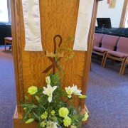 flowers in front of lectern
