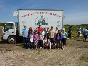 group in front of truck